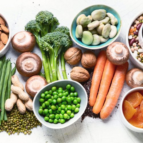 Food sources of plant based protein. Healthy diet with  legumes, dried fruit, seeds, nuts and vegetables.  Foods high in protein, antioxidants, vitamins and fiber.